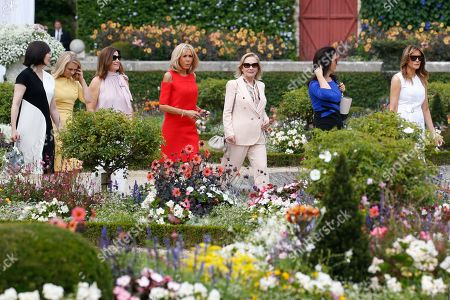 Brigitte Macron (C), wife of French President Emmanuel Macron, U.S. First Lady Melania Trump (R), Akie Abe (L), wife of Japan's Prime Minister Shinzo Abe, Jenny Morrison (3-L), wife of Australia's Prime Minister Scott Morrison, Malgorzata Tusk (2-L), wife of European Council President Donald Tusk and Adele Malpass (2-R), wife of World Bank President David Malpass and Chile's First Lady Cecilia Morel (3-R) walk in the garden of the Villa Arnaga, House-museum of Edmond Rostand during a tour on a traditional Basque culture as part of the G7 summit, in Espelette, near Biarritz, France, 25 August  2019.  The G7 Summit runs from 24 to 26 August in Biarritz.