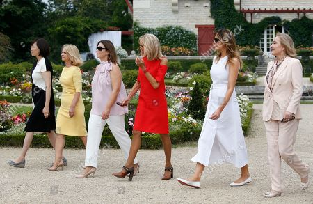 Brigitte Macron (3-R), wife of French President Emmanuel Macron, U.S. First Lady Melania Trump (2-R), Akie Abe (L), wife of Japan's Prime Minister Shinzo Abe, Jenny Morrison (3-L), wife of Australia's Prime Minister Scott Morrison, Malgorzata Tusk (2-L), wife of European Council President Donald Tusk and Chile's First Lady Cecilia Morel (R) walk in the garden of the Villa Arnaga, House-museum of Edmond Rostand during a tour on a traditional Basque culture as part of the G7 summit, in Espelette, near Biarritz, France, 25 August  2019.  The G7 Summit runs from 24 to 26 August in Biarritz.