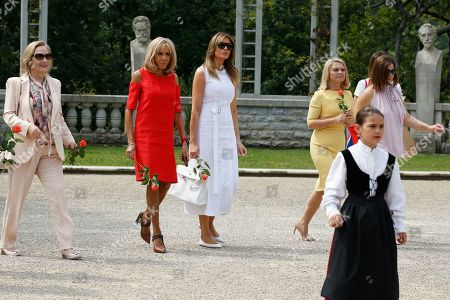 Stock Picture of Brigitte Macron (2-L), wife of French President Emmanuel Macron, U.S. First Lady Melania Trump (C), Jenny Morrison (R), wife of Australia's Prime Minister Scott Morrison, Malgorzata Tusk (2-R), wife of European Council President Donald Tusk and Chile's First Lady Cecilia Morel (L) walk in the garden of the Villa Arnaga, House-museum of Edmond Rostand during a tour on a traditional Basque culture as part of the G7 summit, in Espelette, near Biarritz, France, 25 August  2019.  The G7 Summit runs from 24 to 26 August in Biarritz.