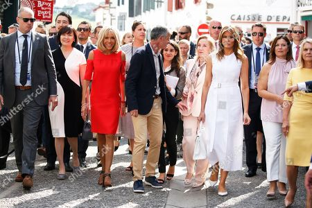 Brigitte Macron (3-L), wife of French President Emmanuel Macron, and Espelette mayor Jean-Marie Iputcha (C) walk in the streets with U.S. First Lady Melania Trump (3-R), Akie Abe (2-L), wife of Japan's Prime Minister Shinzo Abe, Chile's First Lady Cecilia Morel (4-R), Jenny Morrison (2-R), wife of Australia's Prime Minister Scott Morrison, Malgorzata Tusk (R), wife of European Council President Donald Tusk during a visit on traditional Basque culture as part of the G7 summit, in Espelette, near Biarritz, France, 25 August 2019. The G7 Summit runs from 24 to 26 August in Biarritz.