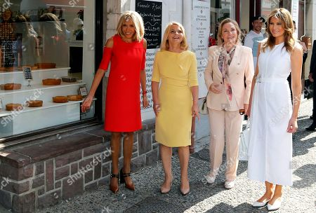Brigitte Macron (L), wife of French President Emmanuel Macron, U.S. First Lady Melania Trump (R), Chile's First Lady Cecilia Morel (2-R), and Malgorzata Tusk (2-L), wife of European Council President Donald Tusk pose in front of a bakery during a visit on traditional Basque culture as part of the G7 summit, in Espelette, near Biarritz, France, 25 August 2019. The G7 Summit runs from 24 to 26 August in Biarritz.