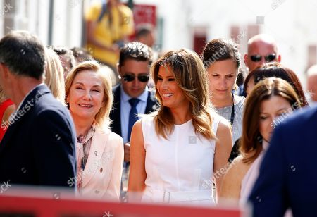 U.S. First Lady Melania Trump (C) and Chile's First Lady Cecilia Morel (L) walk in the streets during a visit on traditional Basque culture as part of the G7 summit, in Espelette, near Biarritz, France, 25 August 2019. The G7 Summit runs from 24 to 26 August in Biarritz.
