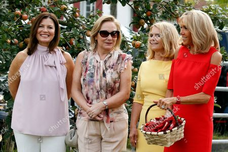 Brigitte Macron (R), wife of French President Emmanuel Macron, Chile's First Lady Cecilia Morel (2-L), Jenny Morrison (L), wife of Australia's Prime Minister Scott Morrison and Malgorzata Tusk (2-R), wife of European Council President Donald Tusk, stand in a field of Espelette pepper during a visit on traditional Basque culture as part of the G7 summit, in Espelette, near Biarritz, France, 25 August 2019. The G7 Summit runs from 24 to 26 August in Biarritz.