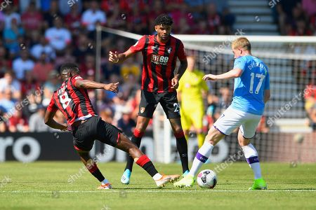 Jefferson Lerma of AFC Bournemouth left tackles Kevin De Bruyne of Manchester City as Philip Billing of AFC Bournemouth looks on during AFC Bournemouth vs Manchester City, Premier League Football at the Vitality Stadium on 25th August 2019