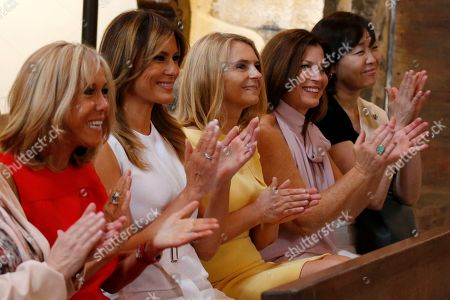 G7 summit in Biarritz. Brigitte Macron, left, wife of French President Emmanuel Macron, U.S. First Lady Melania Trump, second left, Akie Abe, right, wife of Japan's Prime Minister Shinzo Abe, Jenny Morrison, second right, wife of Australia's Prime Minister Scott Morrison, and Malgorzata Tusk, third left, wife of European Council President Donald Tusk applaud as they visit a church in Espelette, near Biarritz, southwestern France, . Melania Trump, Brigitte Macron and other world leaders' wives are visiting the home of a famed French red pepper and tasting Basque country wine on the sidelines of the G-7 summit