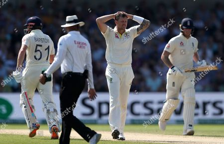 Australian bowler James Pattinson, centre, reacts during play on day four of the third Ashes Test cricket match between England and Australia at Headingley cricket ground in Leeds, England