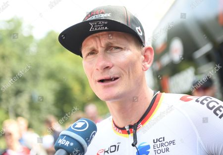 Andre Greipel (Germany) left the team bus before the start of the EuroEyes Cyclassics Cycling race in Hamburg, Germany, 25 August 2019. More than 18.000 competitiors take part in different cycling events during the EuroEyes Cyclassics in Hamburg. The Pro Tour race is the highlight of the cycling event in Hamburg.