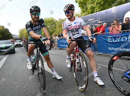 Three times world champion Peter Sagan (L) of Slovakia talks to Andre Greipel (R) of Germany before the start of the EuroEyes Cyclassics Cycling race in Hamburg, Germany, 25 August 2019. More than 18.000 competitiors take part in different cycling events during the EuroEyes Cyclassics in Hamburg. The Pro Tour race is the highlight of the cycling event in Hamburg.