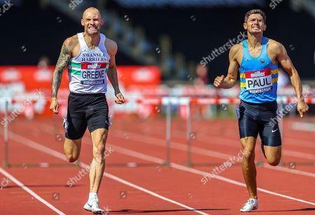Stock Photo of Dai GREENE and Jacob PAUL in the Men's 110m Hurdles Final during the Muller British Athletics Championships at Alexander Stadium, Birmingham