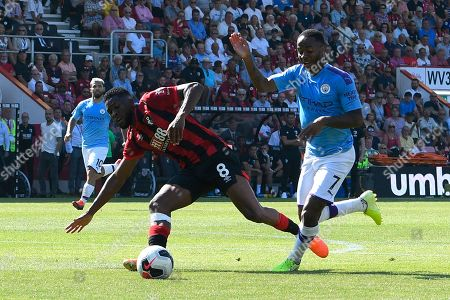 Raheem Sterling (7) of Manchester City battles for possession with Jefferson Lerma (8) of AFC Bournemouth during the Premier League match between Bournemouth and Manchester City at the Vitality Stadium, Bournemouth