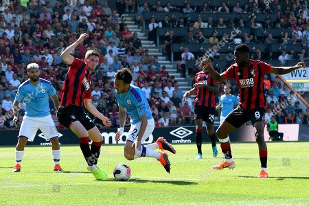 David Silva (21) of Manchester City goes to ground and var checks for a penalty after a challenge by Jefferson Lerma (8) of AFC Bournemouth during the Premier League match between Bournemouth and Manchester City at the Vitality Stadium, Bournemouth