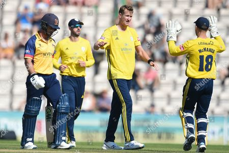 Chris Morris and Lewis McManus of Hampshire celebrates the wicket of Ryan ten Doeschate during the Vitality T20 Blast South Group match between Hampshire County Cricket Club and Essex Eagles at the Ageas Bowl, Southampton
