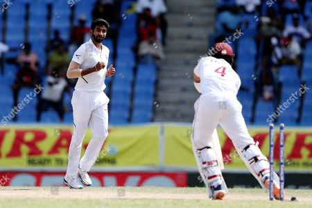 India's Jasprit Bumrah looks at West Indies' Shai Hope after dismissing him during day four of the first Test cricket match at the Sir Vivian Richards cricket ground in North Sound, Antigua and Barbuda