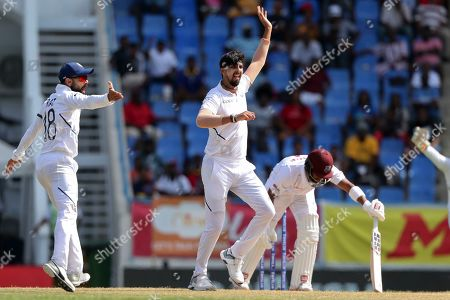 India's bowler Ishant Sharma appeals for the wicket of West Indies' Shai Hope during day four of the first Test cricket match at the Sir Vivian Richards cricket ground in North Sound, Antigua and Barbuda