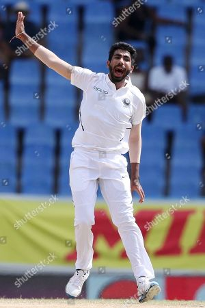 India's Jasprit Bumrah celebrates taking the wicket of West Indies' Shai Hope during day four of the first Test cricket match at the Sir Vivian Richards cricket ground in North Sound, Antigua and Barbuda