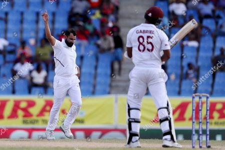Stock Photo of India's Mohammed Shami celebrates taking the wicket of West Indies' Shannon Gabriel during day four of the first Test cricket match at the Sir Vivian Richards cricket ground in North Sound, Antigua and Barbuda