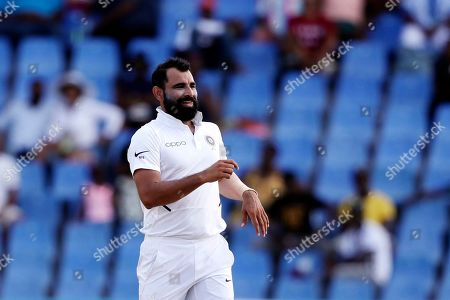 India's Mohammed Shami celebrates taking the wicket of West Indies' Shannon Gabriel during day four of the first Test cricket match at the Sir Vivian Richards cricket ground in North Sound, Antigua and Barbuda