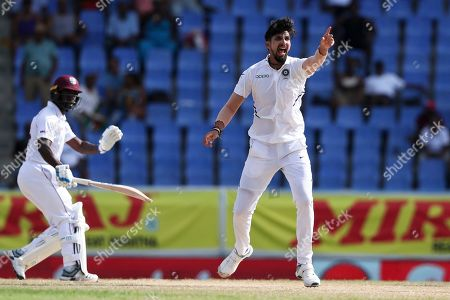 India's Ishant Sharma appeals for the wicket of West Indies' Kemar Roach during day four of the first Test cricket match at the Sir Vivian Richards cricket ground in North Sound, Antigua and Barbuda