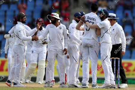Stock Photo of Players of India celebrate beating West Indies by 318 runs at the end of day four of the first Test cricket match at the Sir Vivian Richards cricket ground in North Sound, Antigua and Barbuda