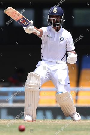 India's Ajinkya Rahane gestures during day four of the first Test cricket match against West Indies at the Sir Vivian Richards cricket ground in North Sound, Antigua and Barbuda