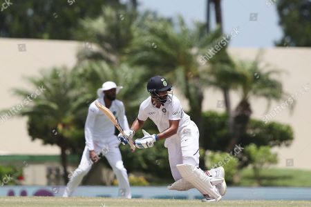 India's Hanuma Vihari plays a shot against West Indies during day four of the first Test cricket match at the Sir Vivian Richards cricket ground in North Sound, Antigua and Barbuda