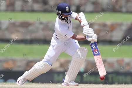 India's Ajinkya Rahane plays a shot against West Indies during day four of the first Test cricket match at the Sir Vivian Richards cricket ground in North Sound, Antigua and Barbuda
