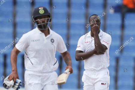 West Indies' Kemar Roach watches India's Hanuma Vihari scoring runs during day four of the first Test cricket match at the Sir Vivian Richards cricket ground in North Sound, Antigua and Barbuda