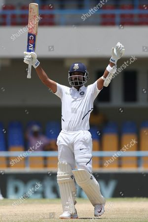 India's Ajinkya Rahane celebrates after he scored a century against West Indies during day four of the first Test cricket match at the Sir Vivian Richards cricket ground in North Sound, Antigua and Barbuda