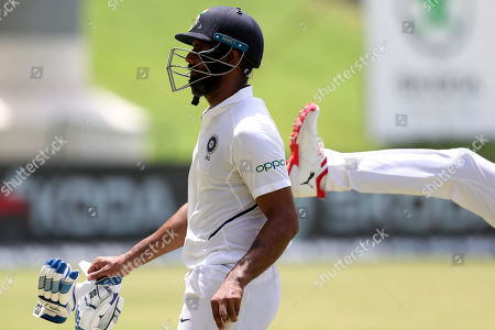 India's Hanuma Vihari leaves the pitch, dismissed for 93 runs, during day four of the first Test cricket match against West Indies at the Sir Vivian Richards cricket ground in North Sound, Antigua and Barbuda