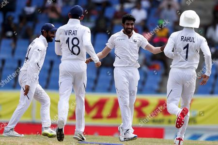 India's Jasprit Bumrah, second from right, celebrates taking the wicket of West Indies' John Campbell during day four of the first Test cricket match at the Sir Vivian Richards cricket ground in North Sound, Antigua and Barbuda