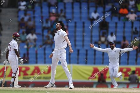India's Ishant Sharma celebrates taking the wicket of West Indies' Shamarh Brooks during day four of the first Test cricket match at the Sir Vivian Richards cricket ground in North Sound, Antigua and Barbuda
