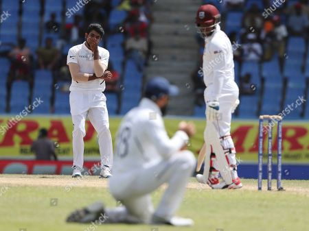 India's bowler Jasprit Bumrah gestures after captain Virat Kohli dropped the catch of a shot played by West Indies' Shimron Hetmyer during day four of the first Test cricket match at the Sir Vivian Richards cricket ground in North Sound, Antigua and Barbuda