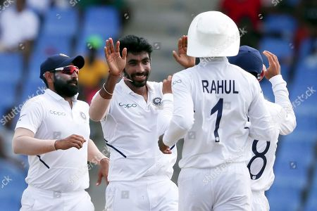 India's Jasprit Bumrah celebrates taking the wicket of West Indies' Darren Bravo during day four of the first Test cricket match at the Sir Vivian Richards cricket ground in North Sound, Antigua and Barbuda