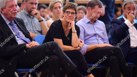(L-R) Hesse State Premier and Christian Democratic Union (CDU) deputy chairman Volker Bouffier, Christian Democratic Union (CDU) party chairwoman Annegret Kramp-Karrenbauer, Saxony State Premier Michael Kretschmer of the Christian Democratic Union (CDU) and North Rhine-Westphalia State Premier Armin Laschet of the Christian Democratic Union (CDU) during a panel discussion with coal miners at the IG BCE trade union headquarters in Dresden, Germany, 25 August 2019. The IG Bergbau, Chemie, Energie is one of Germany's big trade unions, representing workers from the mining, chemical and energy industry. On 01 September 2019 regional state elections will be held in Saxony and Brandenburg. The coal industry and its impact on the climate change is one of the big campaigning issues in the brown coal mining area of Saxony.