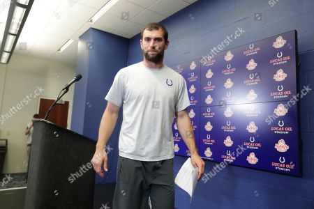 Indianapolis Colts quarterback Andrew Luck leaves the podium after speaking at a news conference following an NFL preseason football game against the Chicago Bears, in Indianapolis. The oft-injured star is retiring at age 29