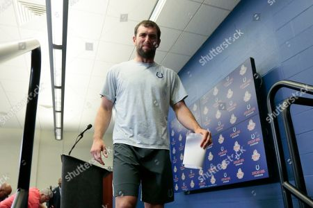 Indianapolis Colts quarterback Andrew Luck leaves the podium after speaking during a news conference following an NFL preseason football game against the Chicago Bears, in Indianapolis. The oft-injured star is retiring at age 29