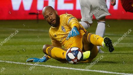 Colorado Rapids goalkeeper Tim Howard (1) makes a save against Real Salt Lake in the first half of a MLS soccer match, in Sandy, Utah