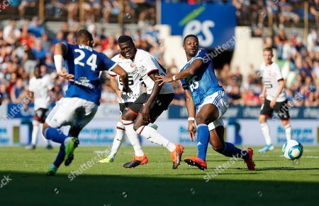 Rennes' Niang Mbaye, center, is challenged by Strasbourg's Martin Jonas, right, during the Soccer League One match between Strasbourg and Rennes in Strasbourg, Eastern France