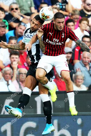 Udinese's Rolando Mandragora (L) in action against Milan's Davide Calabria (R) during the Italian Serie A soccer match between Udinese Calcio and AC Milan in Udine, Italy, 25 August 2019.
