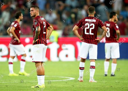 Milan's Davide Calabria (2-L) and his teammates show their dejection after losing the Italian Serie A soccer match between Udinese Calcio and AC Milan in Udine, Italy, 25 August 2019.