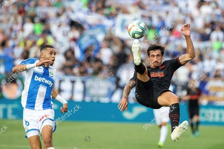 Stock Image of Leganes' forward Youssef En-Nesyri (L) vies for the ball against Atletico de Madrid's defender Stefan Savic (R) during the Spanish LaLiga match between CD Leganes and Atletico Madrid at Butarque stadium in Madrid, Spain, 25 August 2019.