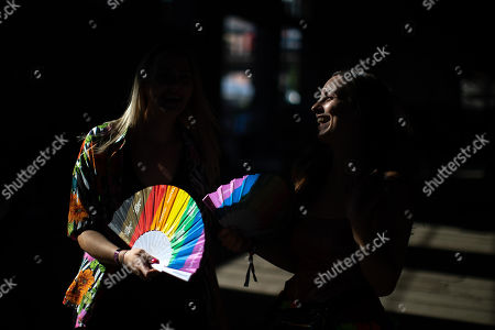 In temperatures exceeding 30 degrees centigrade, fans of Ariana Grande and other musical acts gather at Mayfield Depot ahead of performances.