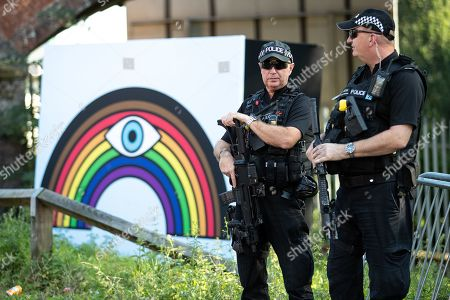 Armed police patrol in and outside the venue as fans of Ariana Grande and other musical acts arrive at Mayfield Depot ahead of performances.