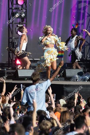 Pixie Lott performs on the stage. Fans of Ariana Grande and other musical acts gather at Mayfield Depot ahead of performances.