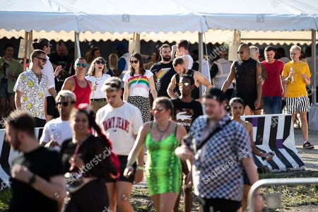 Fans of Ariana Grande and other musical acts arrive through security at Mayfield Depot ahead of performances.