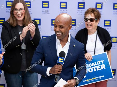 Stock Photo of Human Rights Campaign president Alphonso David, center, endorses Sarah McBride, left, for Delaware state senate at Wilmington Brew Works in Wilmington, Del