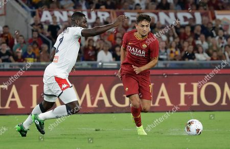 Roma's Cengiz Under, right, dribbles past Genoa's Cristian Zapata during the Serie A soccer match between Roma and Genoa at the Rome Olympic stadium