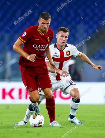 Roma's Edin Dzeko (L) in action against Genoa's Lukas Lerager (R) during the Italian Serie A soccer match between AS Roma and Genoa CFC at Olimpico stadium in Rome, Italy, 25 August 2019.