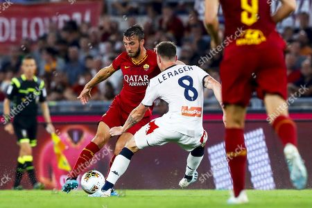 Roma's Bryan Cristante (L) in action against Genoa's Lukas Lerager (R) during the Italian Serie A soccer match between AS Roma and Genoa CFC at Olimpico stadium in Rome, Italy, 25 August 2019.