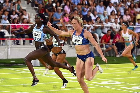 South Africa's Carina Horn (C) and Tori Bowie (L) of the USA compete during the women's 100m race of the 37th Madrid Athletics Meeting in Madrid, Spain, 25 August 2019.